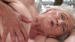A nasty venerable granny is fucked on the side hard by a dude really hard