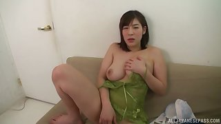 Busty Japanese solitarily carve Otomi Rina strips together with exposes her huge tits